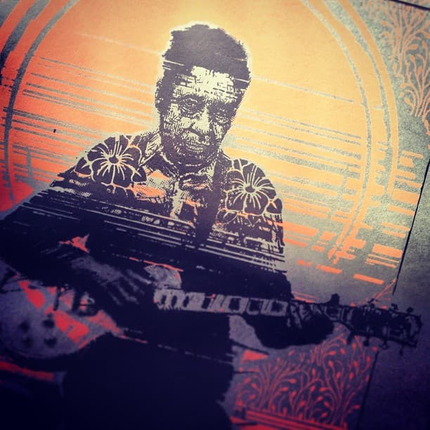 Screen print of RL Burnside playing guitar